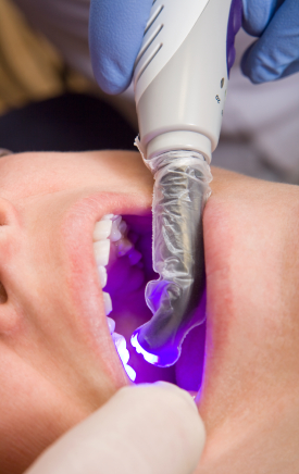 A woman receiving a dental filling .