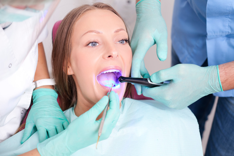 Woman receiving sealants during dental exam at Palani Center for Dental Implants to prevent cavities