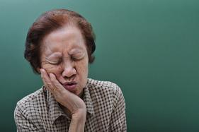 An elderly woman suffering from tooth infection!